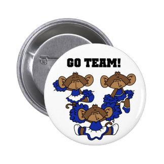 Va las camisetas del equipo y los regalos azules y pin redondo de 2 pulgadas