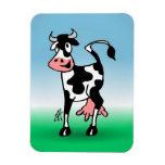 Vaca alegre en un prado imán