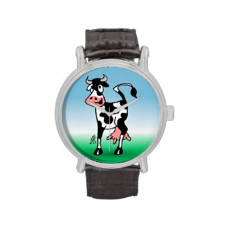 Vaca alegre en un prado relojes de mano