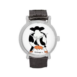 Vaca blanco y negro detrás del reloj