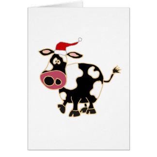 Vaca blanco y negro en el gorra de Santa Tarjeton
