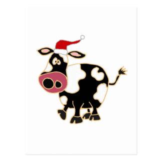 Vaca blanco y negro en el gorra de Santa Postales
