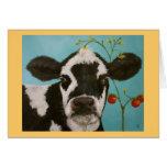 Vaca con la tarjeta de los tomates de cereza