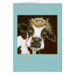 vaca con la tarjeta del gorra de la jerarquía