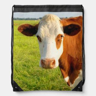 Vaca del frisio de la vista delantera mochila