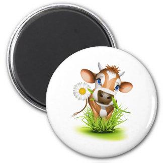 Vaca del jersey en hierba imán