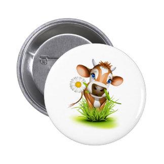 Vaca del jersey en hierba pins
