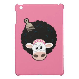 Vaca divertida con un Afro y peine en rosa