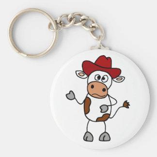 Vaca divertida que lleva el gorra de vaquero rojo llavero redondo tipo pin