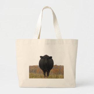 Vaca en pasto bolsas
