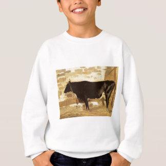 Vaca en un estable (también conocido como la vaca remeras
