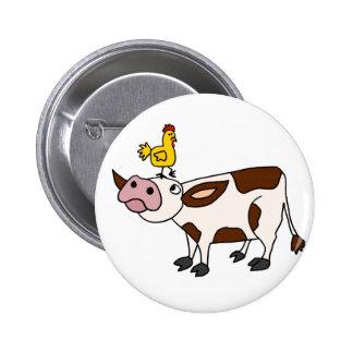Vaca enrrollada con el pollo en su dibujo animado  pins