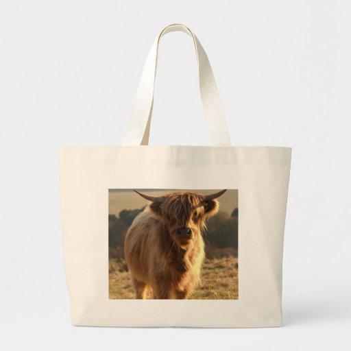 Vaca joven de la montaña bolsas lienzo