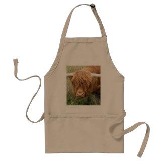 Vaca lanuda de la montaña delantal