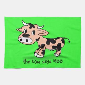 Vaca modelada del dibujo animado en verde con el toallas de cocina