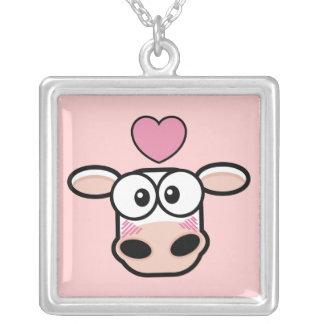 Vaca pegada amor con el corazón colgante cuadrado