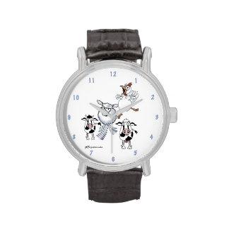 Vaca, toro, ovejas y pollo del dibujo animado en u relojes
