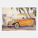 Vacaciones de familia del vintage en un coche conv toallas de mano