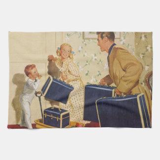 Vacaciones de familia del vintage, maletas de los toalla de mano
