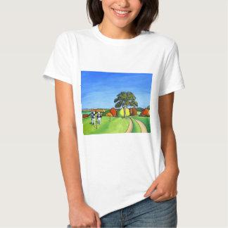 Vacas blancos y negros por el carril del país playeras