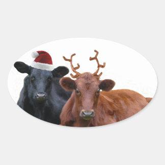 Vacas del día de fiesta del navidad en el gorra y pegatina ovalada