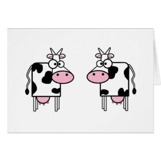 Vacas felices del dibujo animado felicitacion