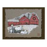 Vacas y granero de la nieve postal