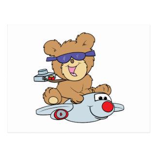 vacation teddy bear in plane postcard
