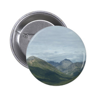 Valley between mountains button