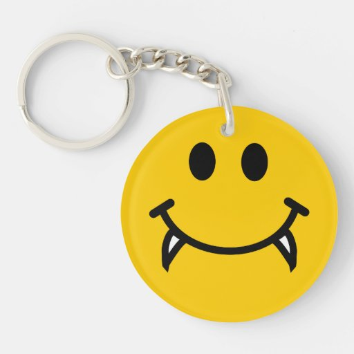 Vampire smiley face with fangs keychain