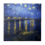 "Van Gogh Starry Night Over The Rhone Tile<br><div class=""desc"">Van Gogh Starry Night Over the Rhone tile. Oil painting on canvas from 1888. One of van Gogh's most beloved night landscapes, Starry Night Over the Rhone captures the night sky bursting over the eastside quay of the French town of Arles. A great gift for fans of van Gogh, post-impressionism,...</div>"