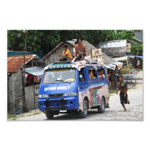 Van with people sitting on the roof. Visayas, Philippines.