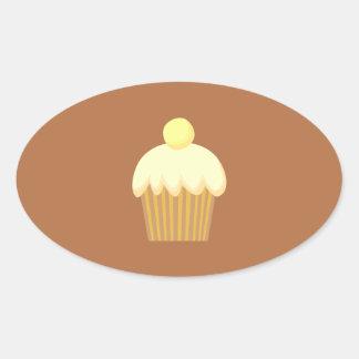 Vanilla Cupcake on Brown. Oval Sticker
