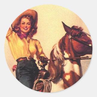 Vaquera en su caballo etiqueta redonda