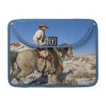 Vaquero con los caballos en la gama en la guarida funda para macbooks
