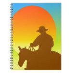 Vaquero de la puesta del sol libreta espiral