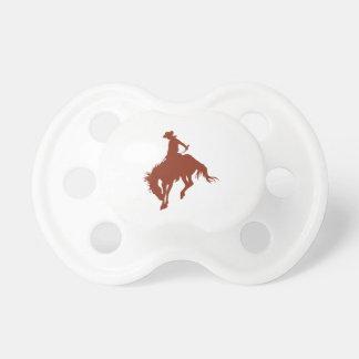 Vaquero del rodeo en tierra de Siena Chupetes De Bebé