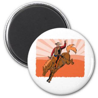 Vaquero del rodeo que monta un caballo salvaje buc imanes de nevera