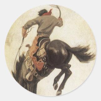Vaquero del vintage en un caballo Bucking del Etiquetas Redondas