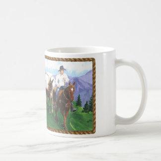 Vaquero en las montañas taza