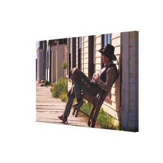 Vaquero en silla en paseo marítimo en Park City Impresión En Lienzo Estirada