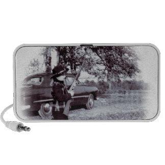Vaquero lindo de la foto del vintage pequeño con e iPod altavoz