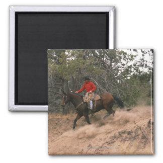 Vaquero que monta cuesta abajo imán de nevera