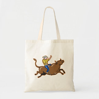 Vaquero que monta una bolsa de asas de Bull