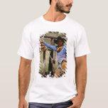 Vaquero que presenta con el lazo y el perro casero playera