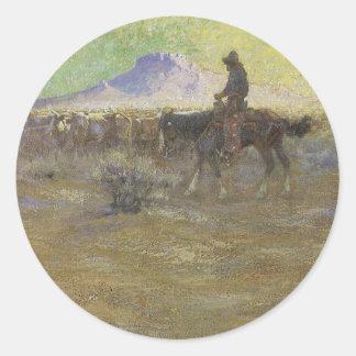 Vaquero que reúne ganado en la gama de Lon Pegatina Redonda