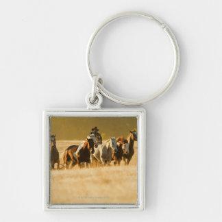 Vaquero que reúne los caballos 2 llaveros