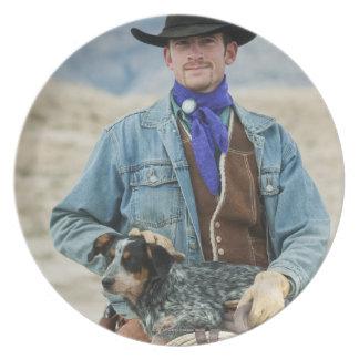 Vaquero y perro en caballo plato