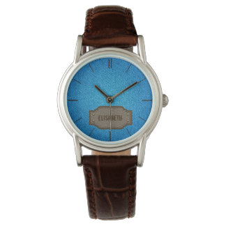 Vaqueros azules del dril de algodón con la relojes de pulsera