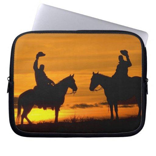 Vaqueros en canto en la puesta del sol mangas computadora
